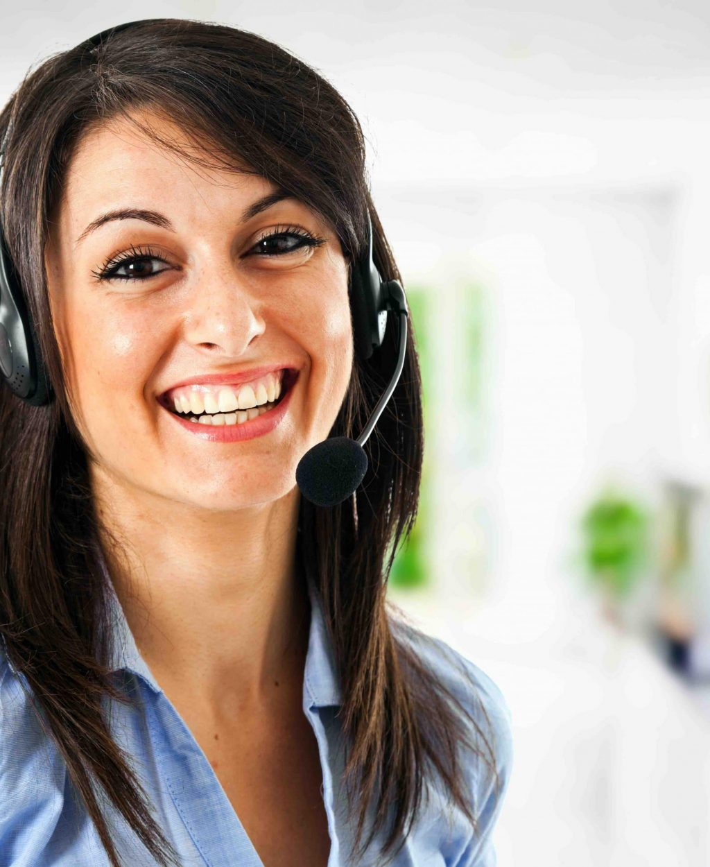 Smiling female customer support assistant wearing phone headset