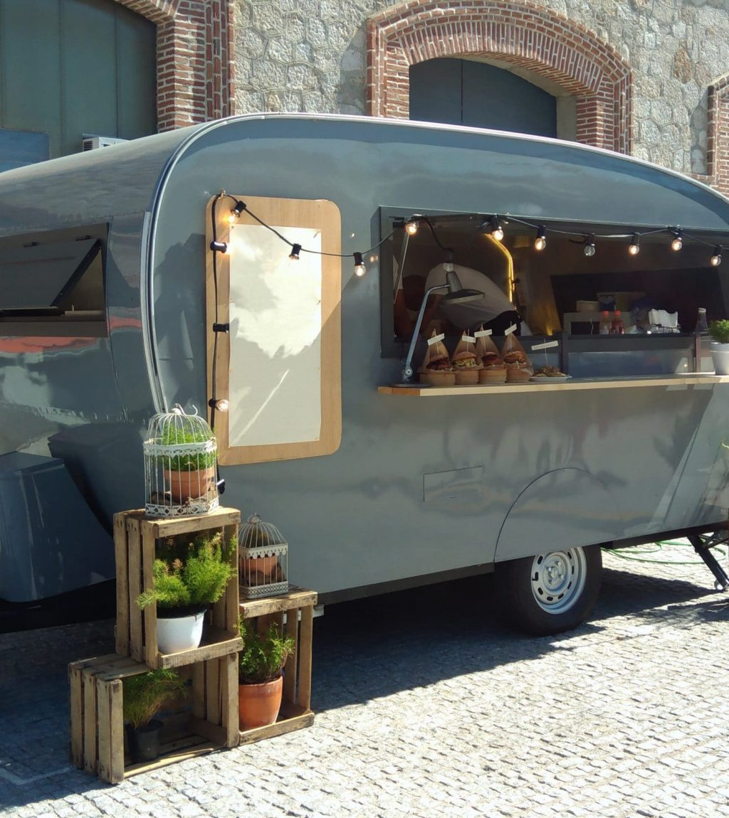 Pretty food outlet caravan with string of lights hanging